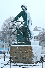 Man at the Wheel Gloucester MA Snowy Day copyright Kim Smith